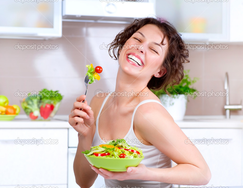 Diet. Beautiful Young Woman Eating Vegetable Salad