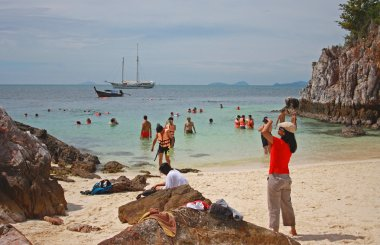 Tourists on the beach, Thailand