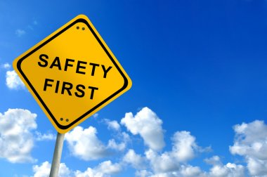 Safety first traffic sign on bluesky