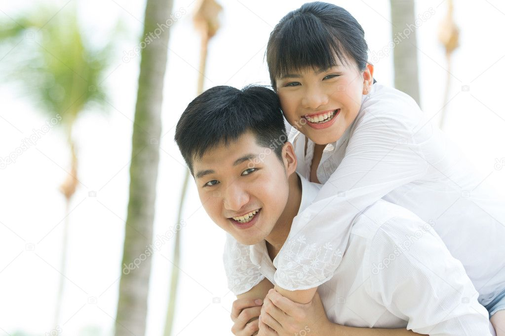 Happy Asian couple.