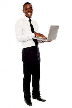 Full length portrait of businessperson holding laptop and using stock vector