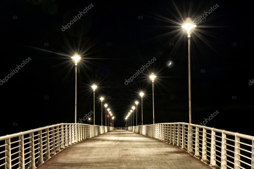 Lamps Post on a pier at night