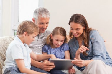 Happy family using a tablet computer