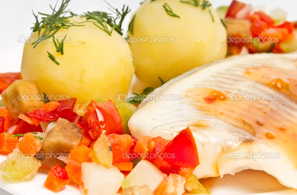 Fish fillet with steamed vegetables and potatoes
