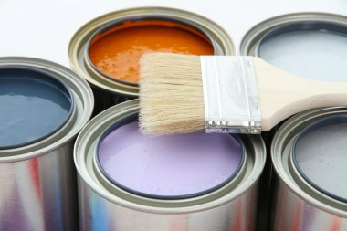 Paint cans ready to be used on white background stock vector