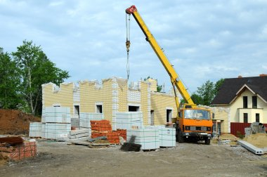 Construction of the new house with a crane.