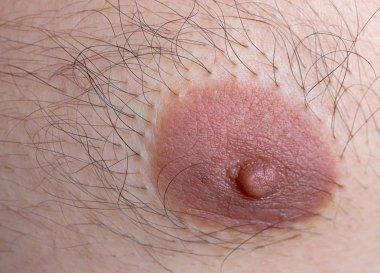 Caucasian man left nipple