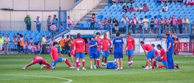 Atletico de Madrid players warming up before the game