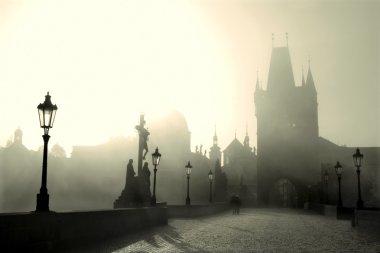 Prague - Charles bridge in morning light and fog