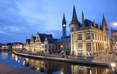 Gent - West facade of Post palace with the canal in evening and Korenlei street on June 24, 2012 in Gent, Belgium.