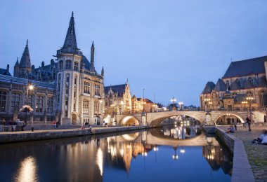 Gent - West facade of Post palace and Michael s bridge with the canal in evening from Graselei street on June 24, 2012 in Gent, Belgium.