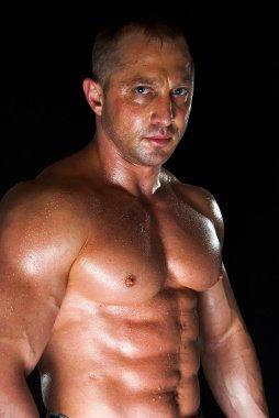Sweaty bodybuilder