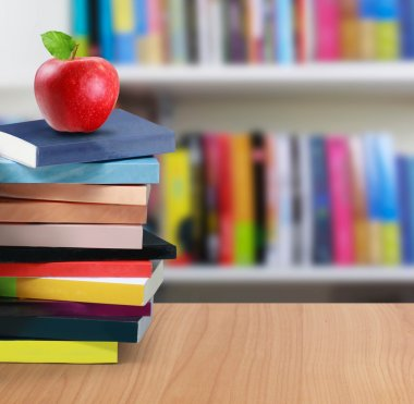 Stack of book and apple