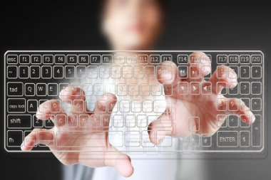 Hand typing on keyboard interface
