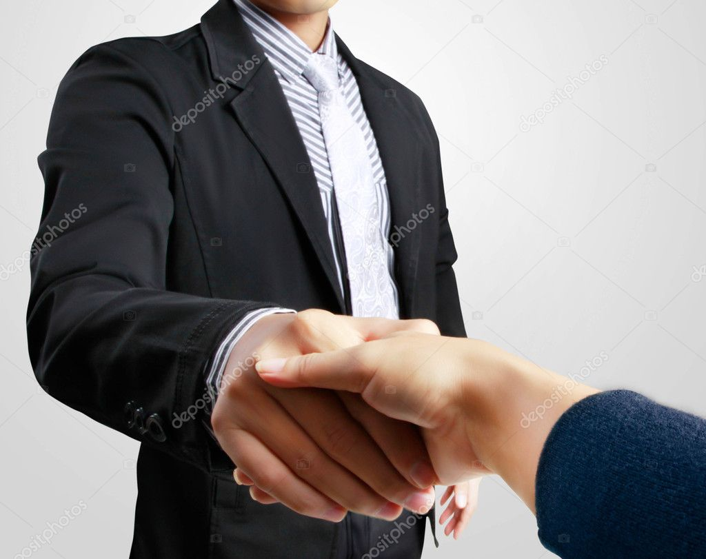 Business woman shaking hands with a man