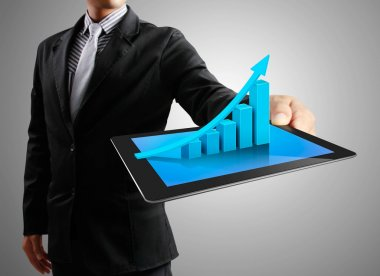 Businessmen and ,graph on a tablet