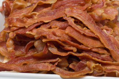 Slices of fried bacon stock vector