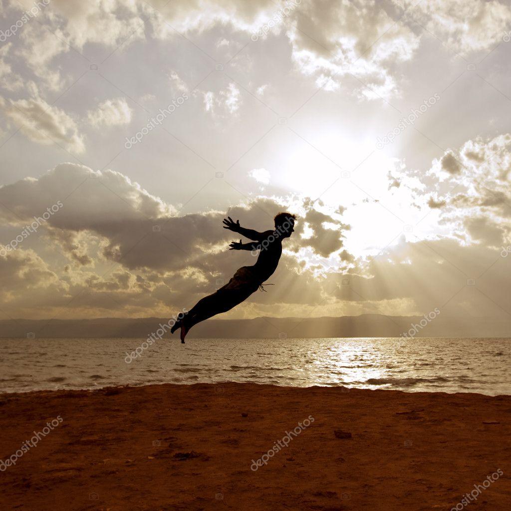 One person acrobatic jumping scene symbolize vitality, aspiration, success, progress