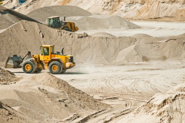 Working machines at gravel pit