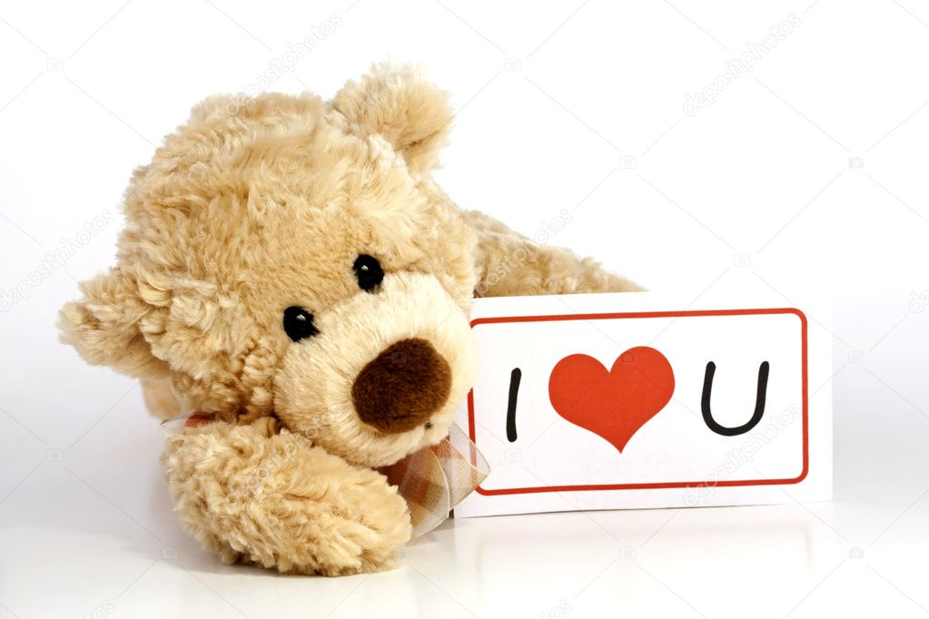 Teddy bear with i love you sign stock photo ar images 11023293 cute furry brown teddy bear laying down holding an i love you sign isolated on white background with copy space photo by ar images voltagebd Images
