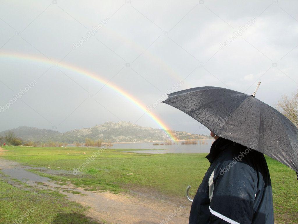 Man looking at the rainbow