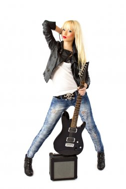 Beautiful woman in blue jeans with black electric guitar