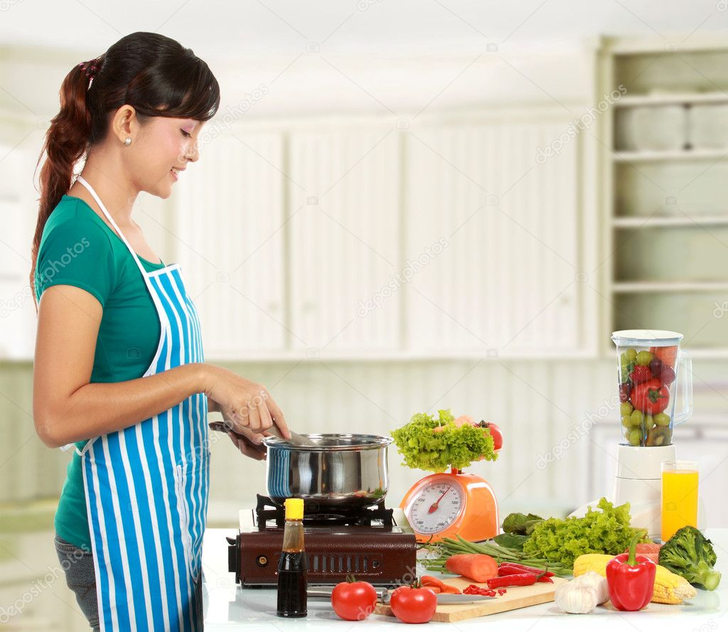 Woman cooking in the kitchen — Stock Photo © odua #11056950