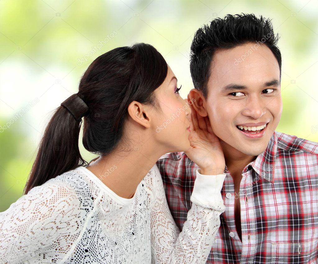 Woman whispering