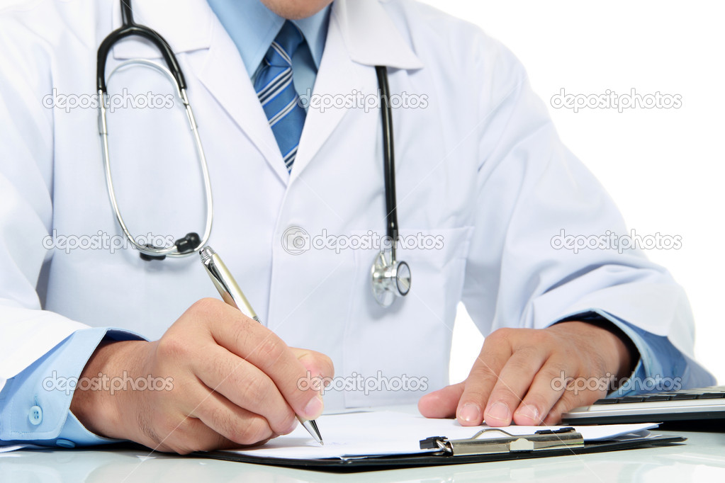 Medical doctor writing a note