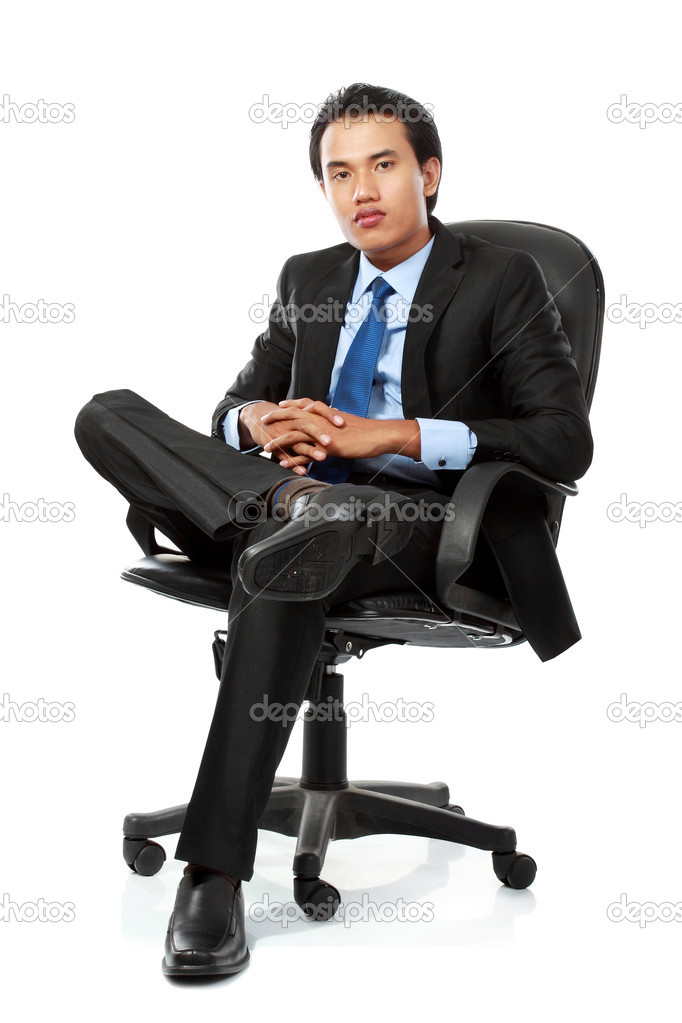 Business man sits on office chair