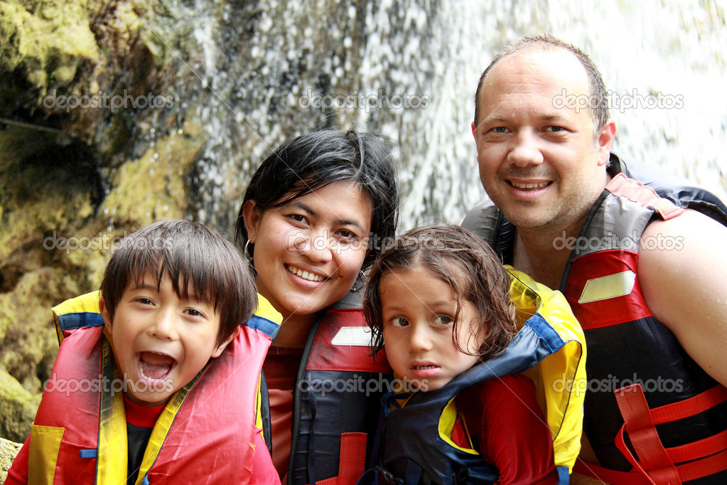 Happy family in the water