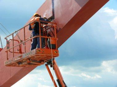 Worker welding a structural node