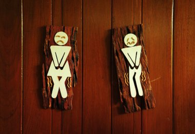 Toilet funny signs on the wood