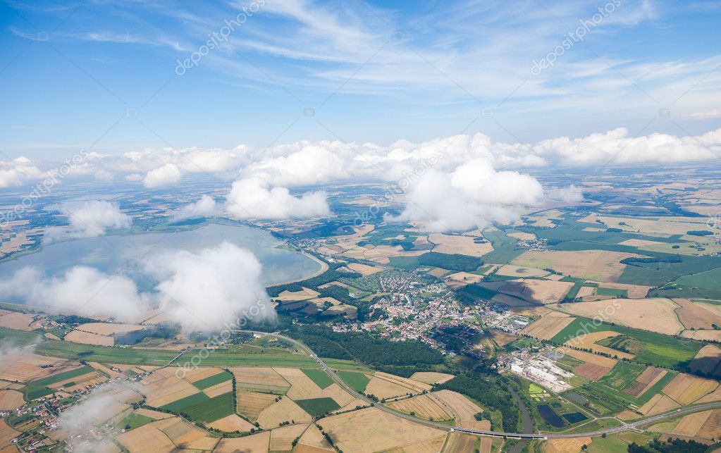 Aerial view of village landscape over clouds