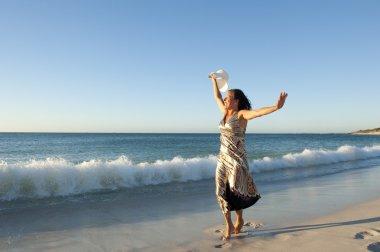 Portrait pretty lady at beach sunset dancing