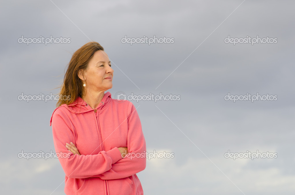 Mature woman relaxed at windy cold day isolated
