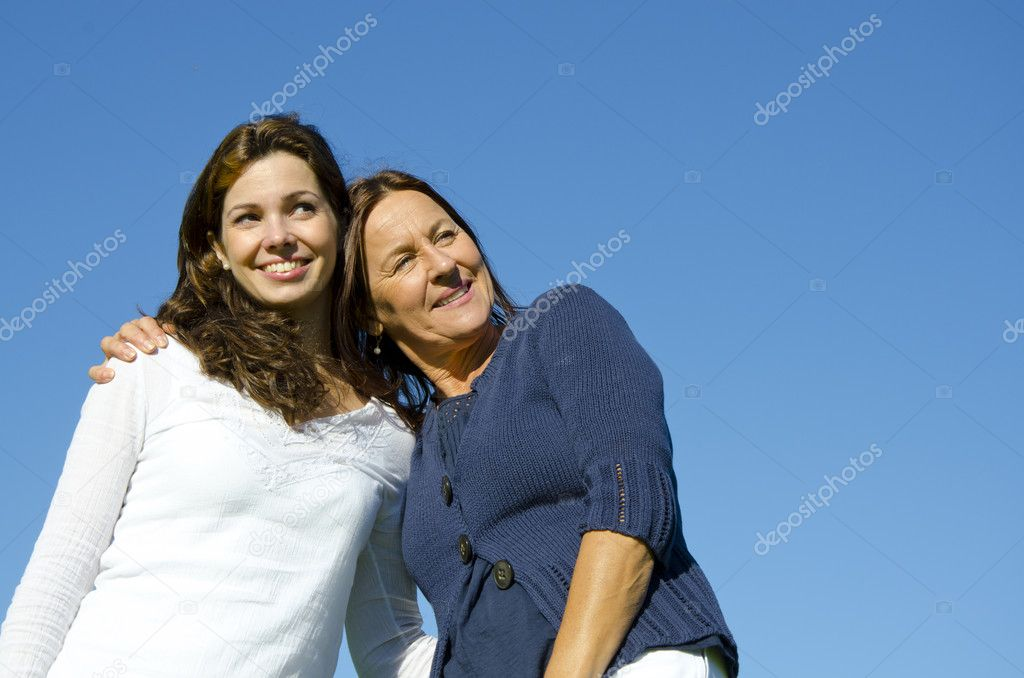 Mother and daughter hugging in friendship