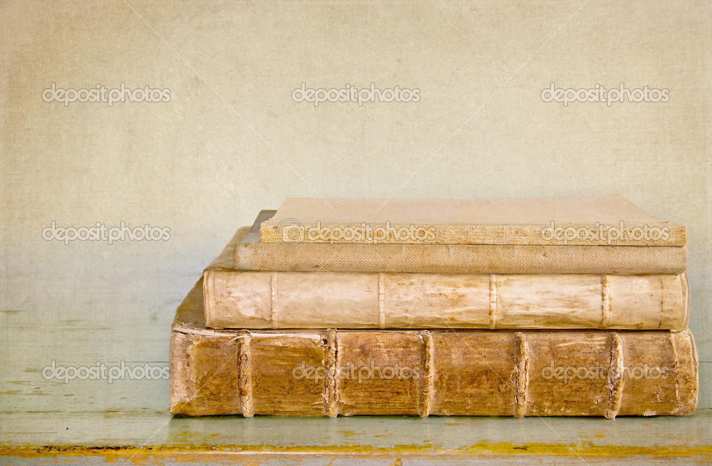 Ancient old books on a wooden table