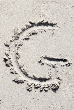 Sand beach alphabet: letter G