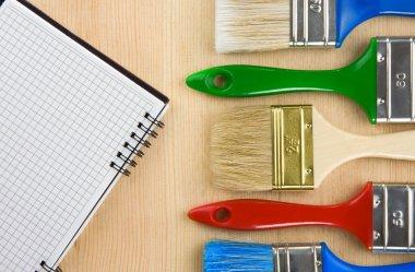 Colorful paintbrush on wood