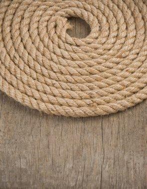 Ship ropes on wood background