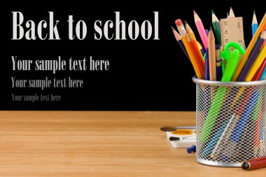 Back to school concept and office supplies isolated on black