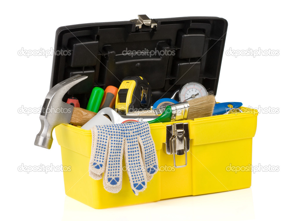 Set of tools on toolbox isolated at white