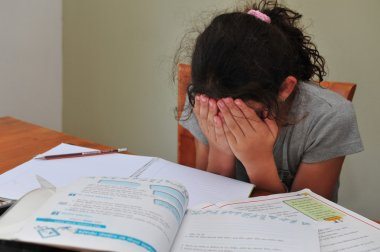 Young Girl Struggles with her homework
