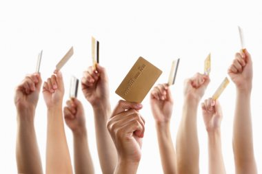Lot of hands holding gold credit card