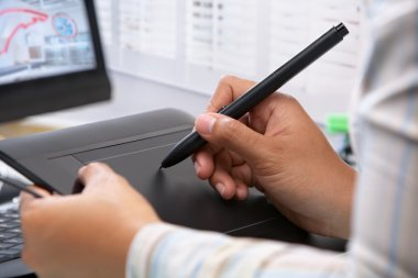 Graphic designer wotking using pen tablet