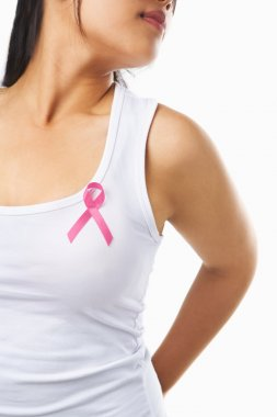 Woman using pink ribbon on her chest to support breast cancer ca