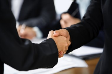 Handshake between two businesswoman