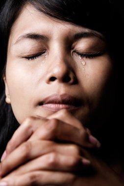 Praying and crying