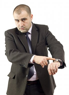 Serious adult businessman pointing to his watch